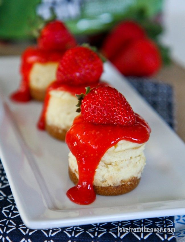 Mini Strawberry Cheesecakes With Homemade Strawberry Sauce Topping.  Love mini desserts and these are perfect for summer!