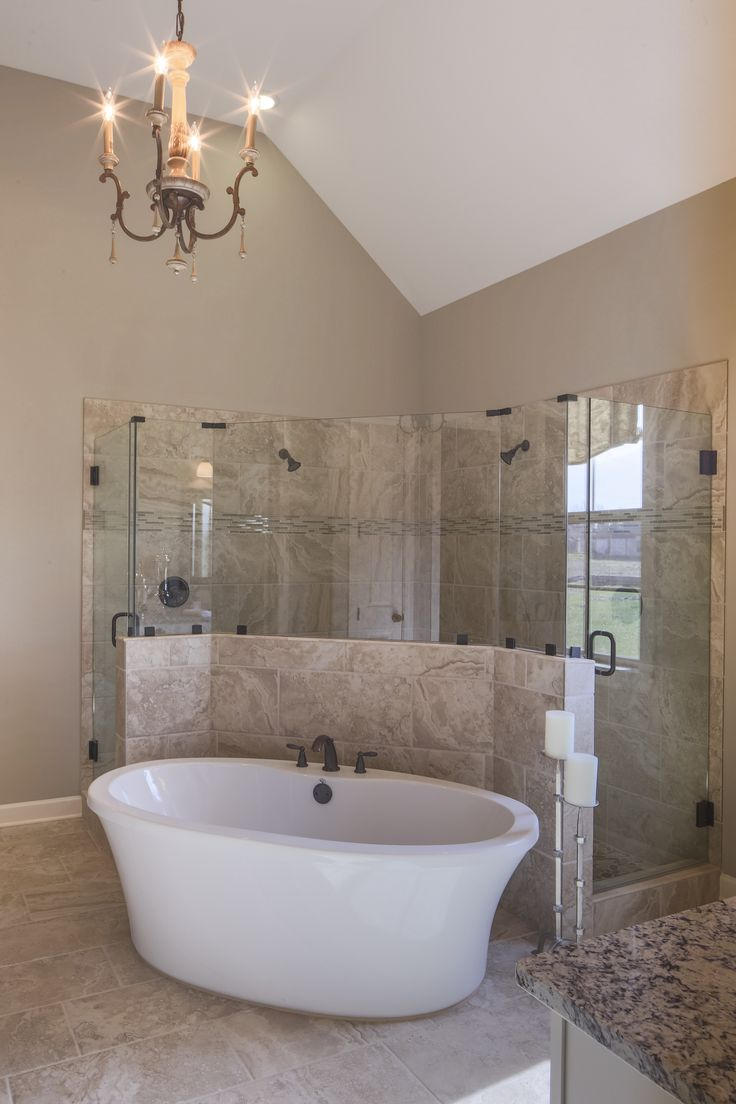 Regency Homebuilders : Master Bath, Drop-In Tub, Walk-Through Shower, Dual Shower, Shower Pebbles, Marbled Tile, Granite, Chandelier, Recessed Lighting, Rustic Style, Black Doors (Windsor Park Bartlett- Riviera Plan)