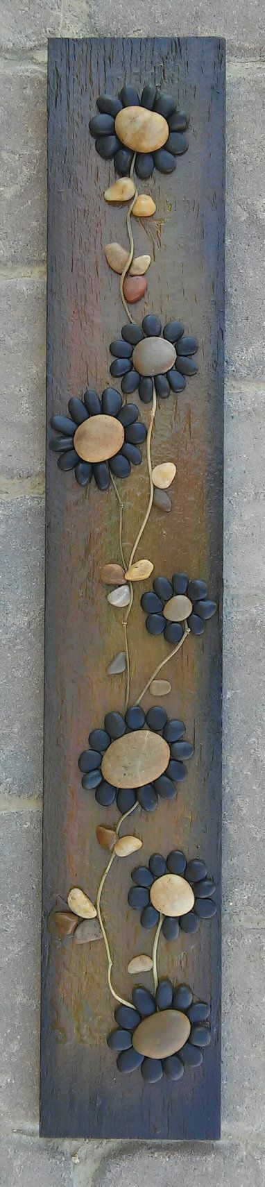 Original pebble/rock art (string of beautiful black flowers) handmade from all natural materials including reclaimed wood, pebbles, twigs