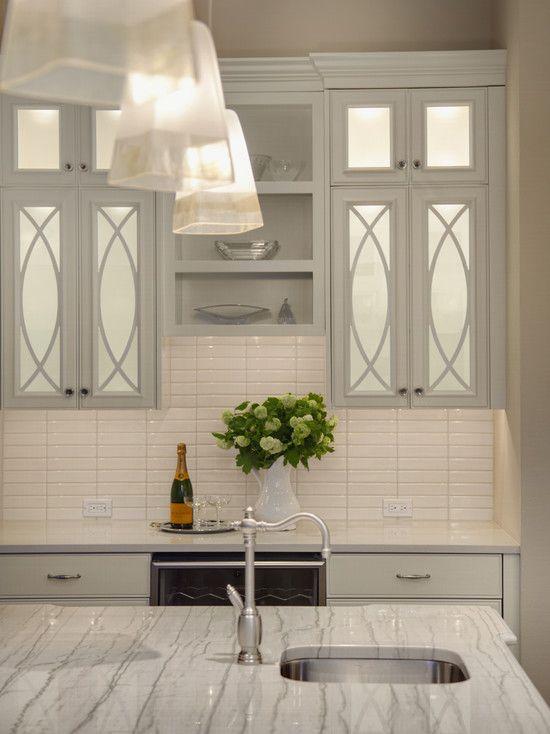 Studio 212 Interiors - kitchens - pale gray kitchen cabinets, mirrored cabinet doors, mirrored kitchen cabinets, quartzite countertops,quartzite island, quartzite kitchen island countertops, white porcelain kitchen tiles,
