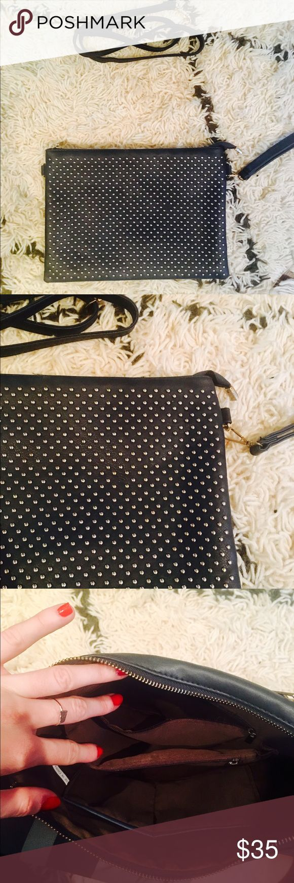 Studded Navy Clutch Gently used navy clutch with fun round studs. I used this bag for a wedding this summer and unfortunately one of the studs came off at some point -- as shown in photos. Despite the minor defect, this bag is excellent! Tons of pockets and a removable cross body strap included!! Bags Clutches & Wristlets