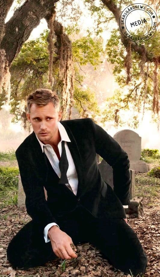Why is he sitting like that in a grave yard? Why would he sit like that anywhere?  Never mind. Doesn't matter.
