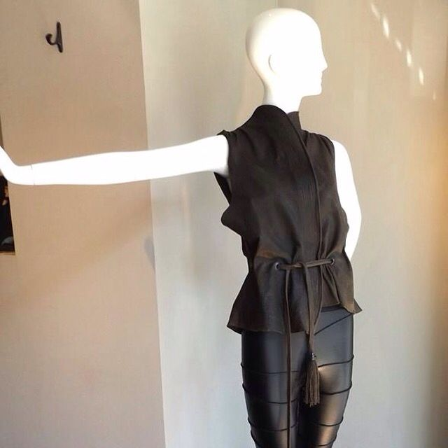 black high waisted leggings with asymmetrical seams washed leather vest, vegetable dye - fitted waist