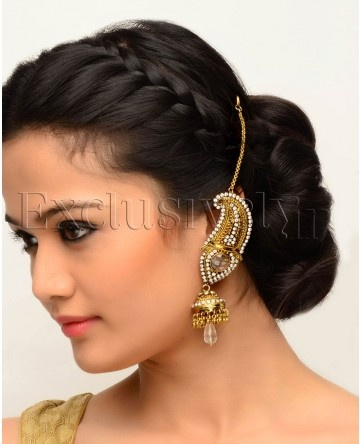 Beautiful low bun with front bohemian braiding. The ear cuff wit hair chain links is beautiful too.