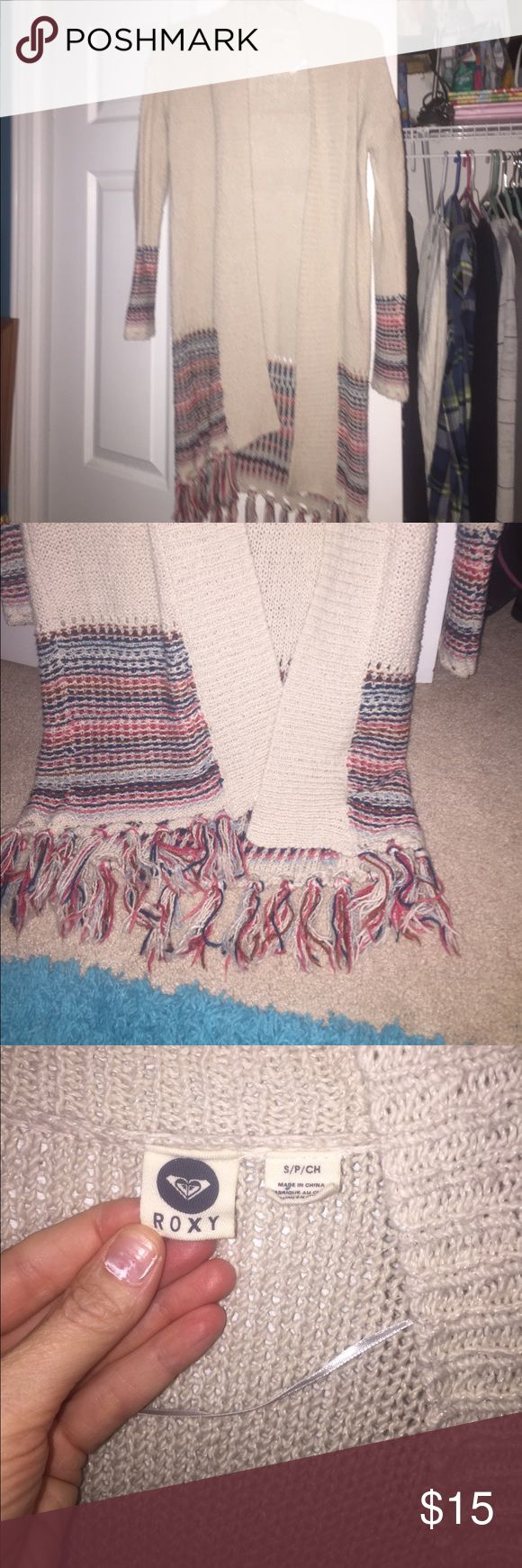 Roxy cardigan NWOT Roxy cardigan fringe at bottom tan with multicolor. Super cute just downsizing 🌸size small but I'm a med and it fit Roxy Sweaters Cardigans