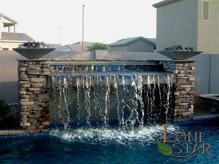 Swimming Pool Water Feature With Stacked Stone Columns And