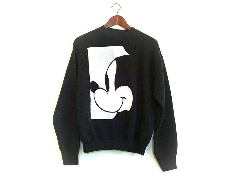 Vintage 1990s black Disney Mickey Mouse silhouette crew sweatshirt by streetstyler on Etsy https://www.etsy.com/listing/531570557/vintage-1990s-black-disney-mickey-mouse