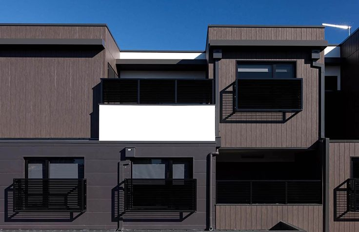 Apartments in VIC use Designer Series Woodgrain Oak in a vertical application. The dark palette pays tribute to the Melbourne vibe...