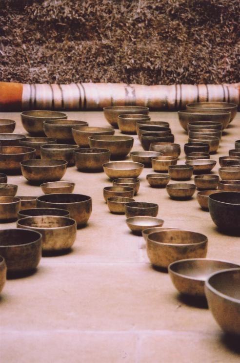 singing bowls market. Tibetan Singing Bowls covering the floor of the Strawbale Studio, June 2004