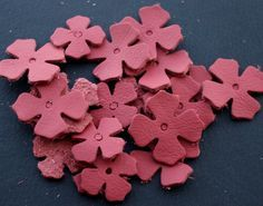 This listing is for 20 leather die cuts in dusty red.  Bigger flower is about 1 inch, smaller flower is about .75 in. You will receive a mixture of