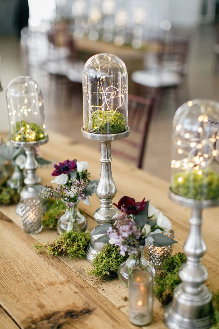 Magical, Festive Fairy Lights For Your Winter Wedding Decor ~ love this moss filled glass dome centerpiece with fairy lights