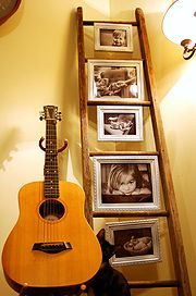 An old wooden ladder is a great context for old family photos. You could also hang it sideways.