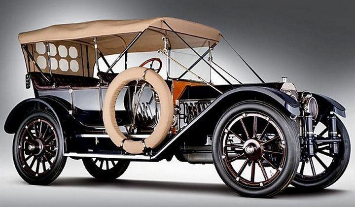 "1912 Oldsmobile Limited Five-Passenger Touring - notice the 42"" wheels and double runningboards in order to get into this huge car!"