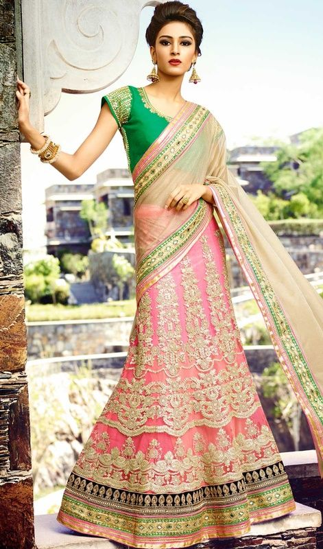 Be the sunshine of everybody's eyes dressed in this beige and pink color embroidered lycra lehenga sari. The ethnic mirror and butta work at the clothing adds a sign of attractiveness statement with your look. #SpectacularALineLehengaSariDesign