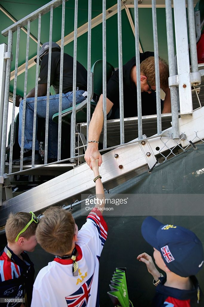 Prince Harry reaches through the railings to shake a young fans hand at the track and field events from the crowd during the Invictus Games Orlando 2016 at ESPN Wide World of Sports on May 10, 2016 in Orlando, Florida. Prince Harry, patron of the Invictus Games Foundation is in Orlando for the Invictus Games 2016. The Invictus Games is the only International sporting event for wounded, injured and sick servicemen and women. Started in 2014 by Prince Harry the Invictus Games uses the power of…