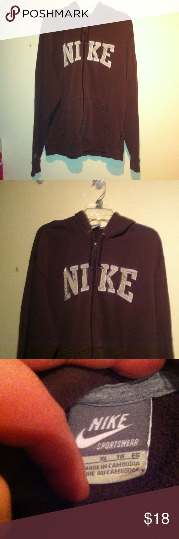 XL men's NIKE brown zip up hooded sweatshirt Men's XL Nike hooded sweatshirt, zip up with front pockets and comfy. It's in great used condition with no holes , rips , or stains . Just alittle bit faded but otherwise excellent condition. It's brown in color and tan and white Nike print across top and nice big front pockets! ; ) authentic and 79% cotton &21% polyester. Zipper works great as well and no loose threads or issues. Great gift! ; ) Nike Shirts Sweatshirts & Hoodies