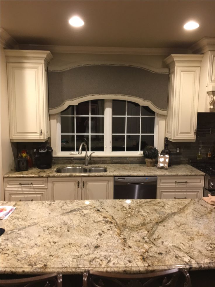 New window treatment blends beautifully with cabinets and colors in granite, backsplash and fabrics in great room....