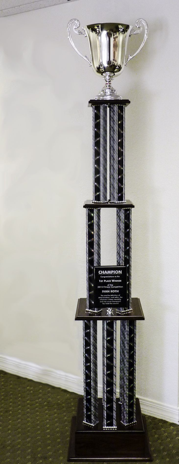 "Need something big? We mean really big! Check out this massive 7 foot tall trophy we made for one of our creative clients! This is a custom 4 tier trophy with black wooden bases, black laser column, an 8"" x 10"" ebony piano plaque. The trophy is topped with a 14"" tall silver loving cup.  #trophy #cup #award #creative #biggerisbetter #trophies #plaque #champion #arizona #tempe #phoenix #smallbusiness #winning"
