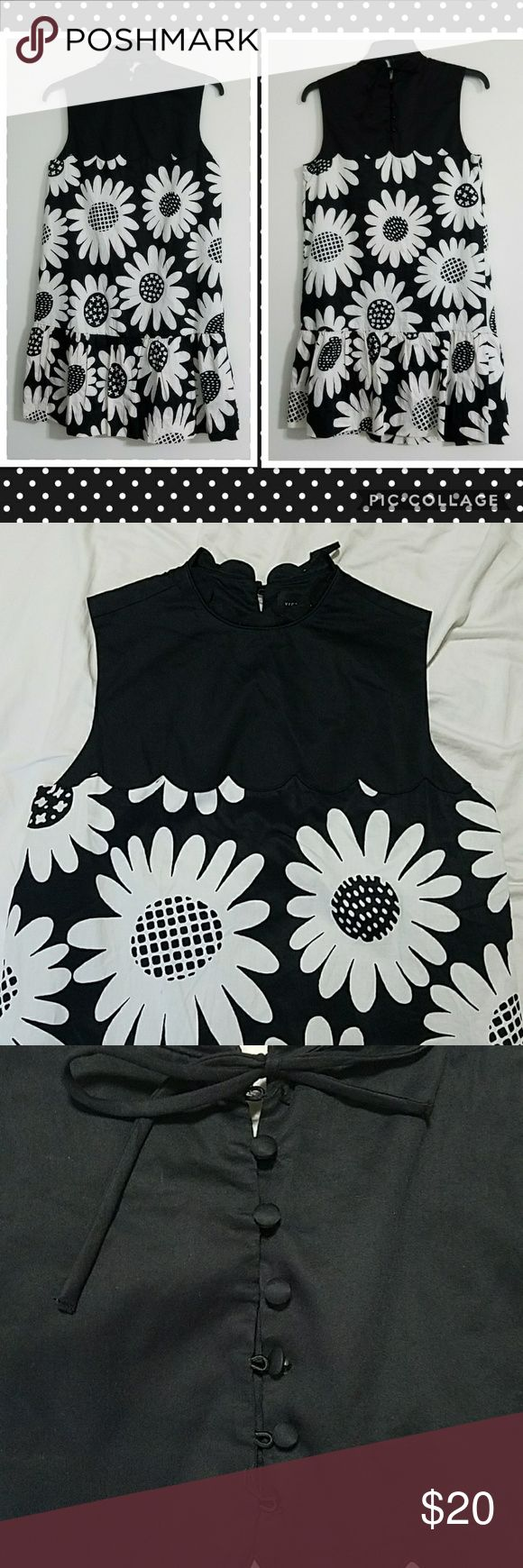 "🌺Black & White Flower Dress NWOT Victoria Beckham for Target Black & White Daisy Drop Waist Scallop Trim Dress  Missing two buttons in back (see photo)   100% polyester Machine washable, gentle cycle  Length: 34.5"" Bust: 17.25"" Inside Lining Hem: 26"" Shoulder: 13.5""  [Model photo taken from ""Fashion Gone Rogue"" Website] Victoria Beckham for Target Dresses"