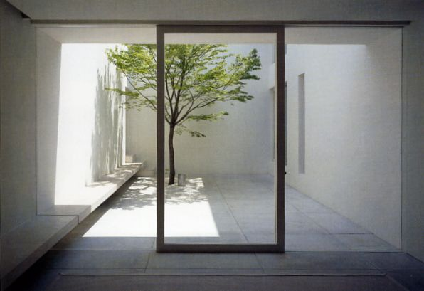 Continuous bench. Simple internal courtyard Tetsuka House by John Pawson.
