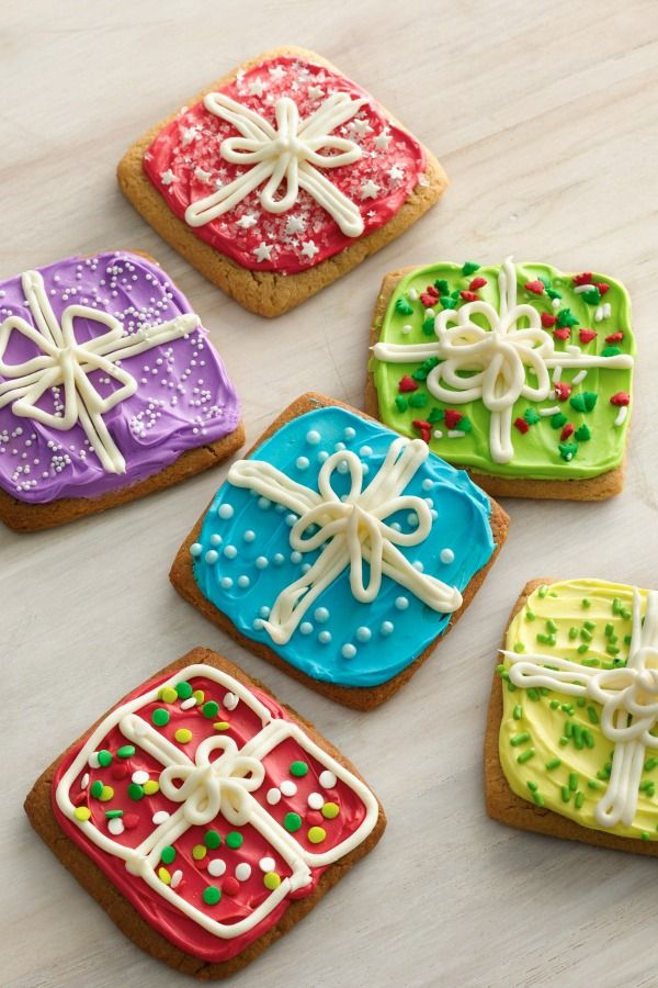 """Your holiday guests won't be able to wait to """"unwrap"""" these brightly colored gifts. A square cookie cutter and a little frosting is all you need; the kids can even get creative with it. Click through for a step-by-step video!"""