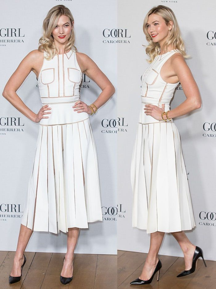 Karlie Kloss donned a crisp, white Carolina Herrera Spring 2016 dress that blended demure in its neat illusion collar, pleated skirt and midi length style with sexiness in its sheer seam inserts design