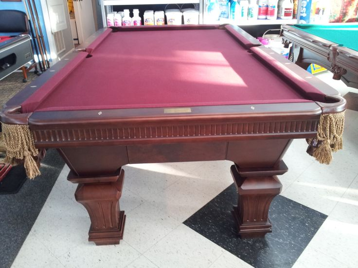 Vanquisher table 1799 has wine colored cloth 1 3pc wood for 1 slate pool table