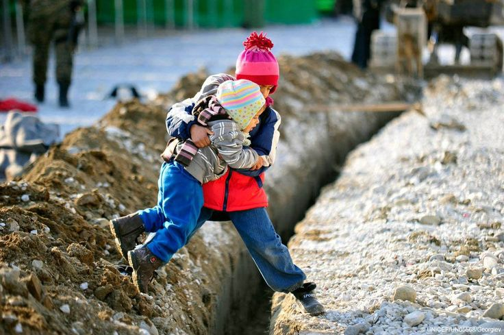 #Bestof2016: Powerful moment - a boy helps his sister across a ditch at a refugee & migrant transit centre in the #fyrMacedonia. #endofyear