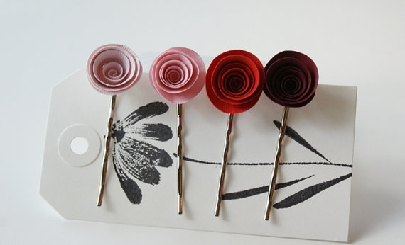 Set of 4 flower bobby pins in varying shades of pink and red.    Wear them separate, or tuck them all into an up do for a pretty floral touch. Perfect for a wedding, sprinkled in the brides hair or to color coordinate bridesmaids. Or if you wish pop one in to hold back stray locks on the go.They have been treated lightly to help withstand the elements however they are still water permeable and shouldn't be submerged.     Your clips will come neatly packaged in a pillow box ready to give as a…
