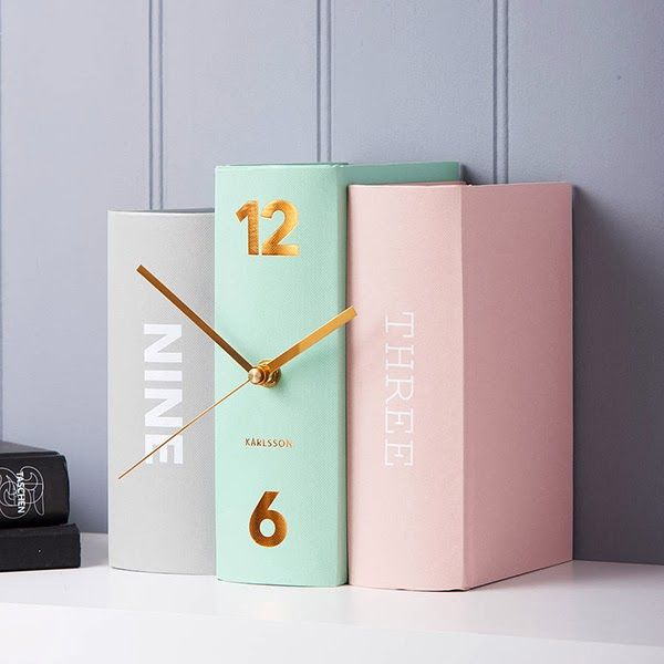 Pastel book clock; can buy a black version from Kikkerland and spray paint your favourite colours!