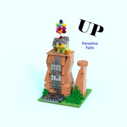 Hi everyone, here is my latest Lego Ideas project based on the house and Paradise Falls from the 2009 Pixar movie 'Up'. This is a micro scale version of Mr Fredrickson's house and the main location, Paradise Falls. This set is based on the part of the movie when the house has balloons attached to it and has just landed at Paradise Falls. This set features the two rock formations of Paradise Falls, a waterfall, lots of foliage, Mr Fredrickson's house, and two micro figures of R...