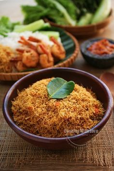 Serundeng is an Indonesian sauteed grated coconut that is often used as a side dish to accompany rice. Freshly shredded coconut, instead of grated coconut left over from making coconut milk, gives a richer taste.