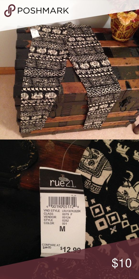 NWT Printed Leggings These black and cream leggings/ pants have elephants on them and geographic patterns. These are new with tags from Rue 21. Seize medium. Never worn. From a smoke free home. Rue 21 Pants Leggings