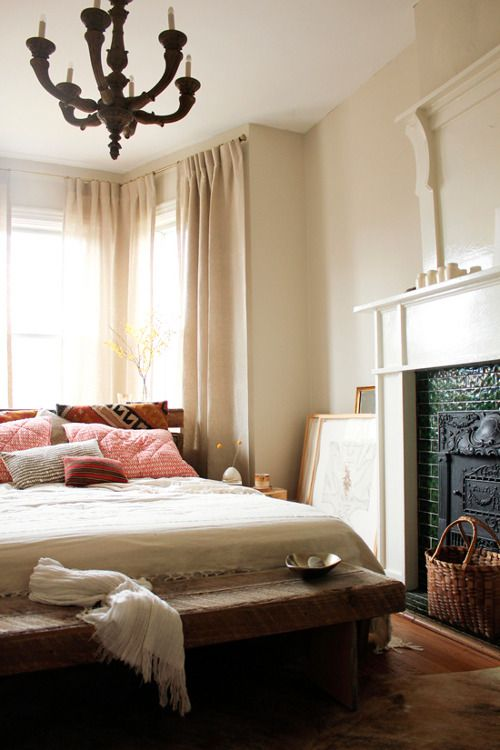Love this look for the guest bedroom- cream walls, ceiling-high curtains, same green fireplace tile.