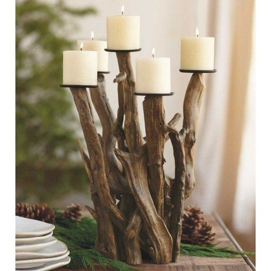 The Ultimate Gift Guide For Home Decor Enthusiasts: Wooden accents lend a warm and earthy vibe. This driftwood candelabra ($239-$279) has a cozy and rustic yet elegant design.