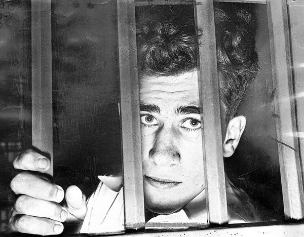 William Heirens peers out of his cell at the Cook County Jail in 1946.
