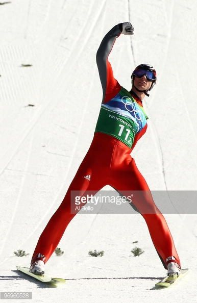 Andreas Wank of Germany reacts after his final jump in the men's ski jumping team event on day 11 of the 2010 Vancouver Winter Olympics at Whistler...