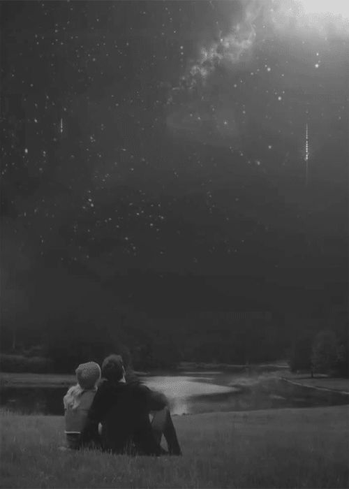 Watching the stars fall black and white night stars couple animated fall gif