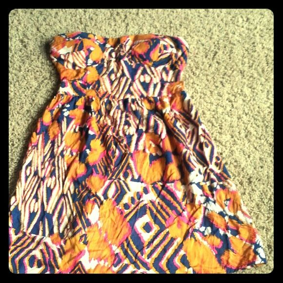Small shirt dress Aztec-ish material. .very soft and comfortable. Very cute with brown leather short jacket and skinny jeans or in summer with cowgirl boots!! Dresses