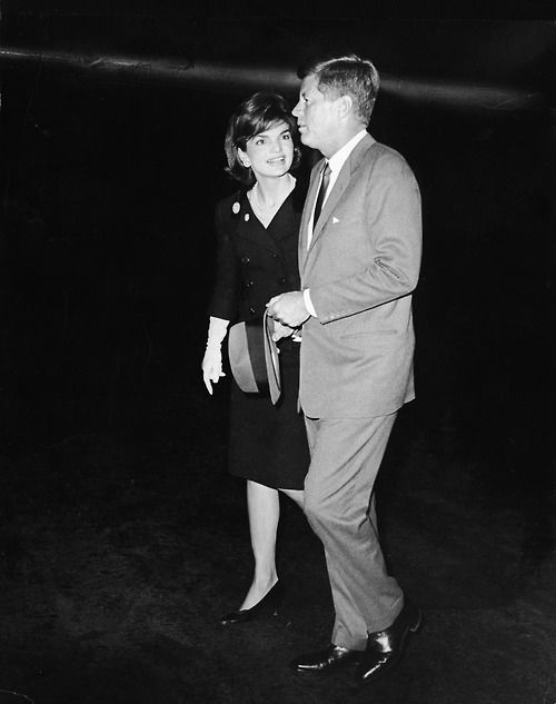 President Kennedy and Mrs. Jacqueline Kennedy walk away from the president's private plane in which Mrs. Kennedy had returned after a visit to India and Pakistan, Washington D.C., 1962.