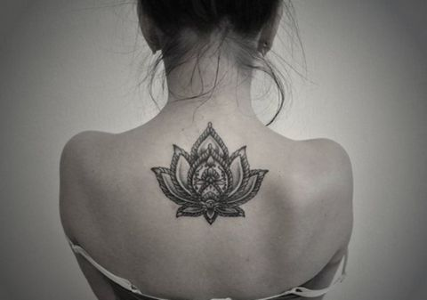 Tribal Lotus Back Tattoo Ideas at MyBodiArt