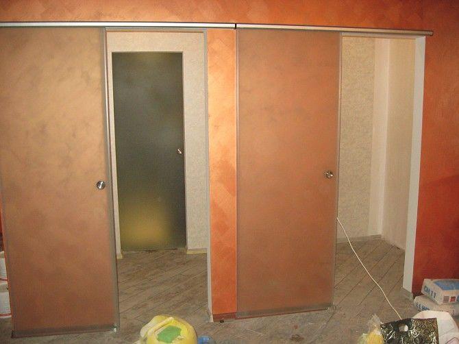 Раздвижные двери с заполнением, алюминиевые раздвижные двери, балконы. Компания выполняет монтажные работы под ключ. Доставка на объект.