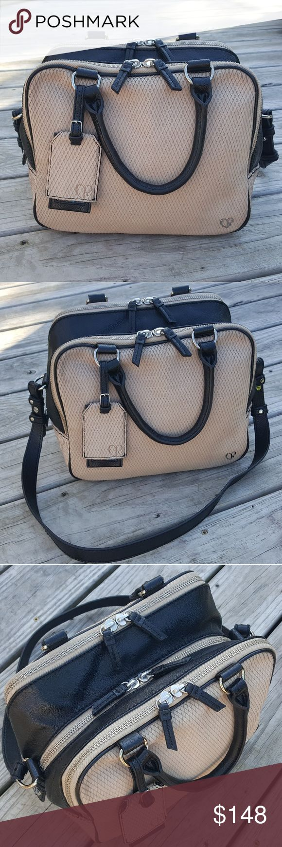 Charlotte Ronson Triple Diamond Leather Satchel This gorgeous leather satchel features black leather and tan suede with a cut diamond pattern. It has 3 large compartments to keep everything organized and a luggage tag accent. It also comes with the original Charlotte Ronson card. It is in good pre-owned condition with only minor signs of wear. As you can see in the last set of photos there is some slight discoloration around some of the edges and some very small black spots on the back of…