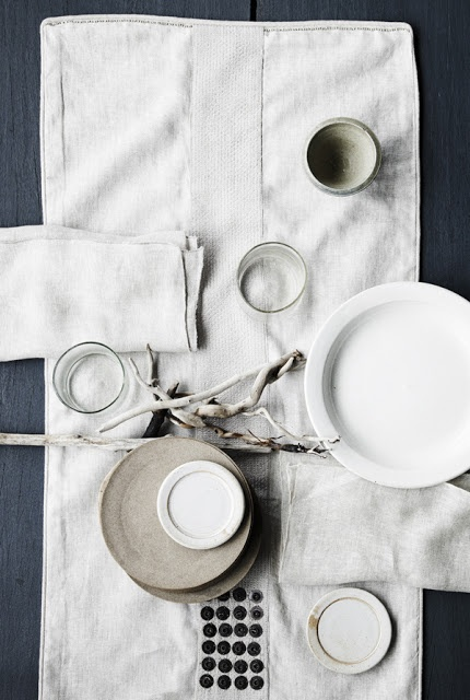 really love blues greys blacks and whites for table top. could look great on your black table, or the wooden breakfast bar?