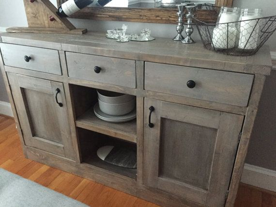 Rustic Style Dining Room Side Board. Includes 2 cabinets, and 3 drawers, and one small area of open shelving. Can be customized with stain and
