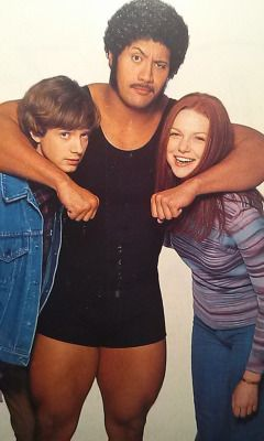 "shitloadsofwrestling:  Topher Grace, The Rock, and Laura Prepon [1999] In season one of That 70's Show, WWF superstars The Hardy Boyz, Ken Shamrock, and The Rock were guest stars on the episode titled ""That Wrestling Show"". The Rock played his father, Rocky Johnson, and talked very highly about his ""son"". Also in the scene was wrestling legend and WWE Hall Of Famer, ""Big Cat"" Ernie Ladd! You can check the scene out here."