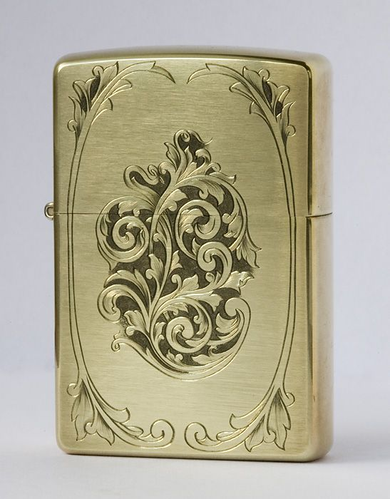 Engraved Zippo found here http://www.viljomarrandi.com/2007/09/latest-engravings-and-microscope-saga/