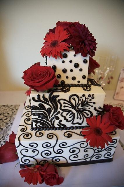 black white wedding cake square tiers with black scroll work black polka dots