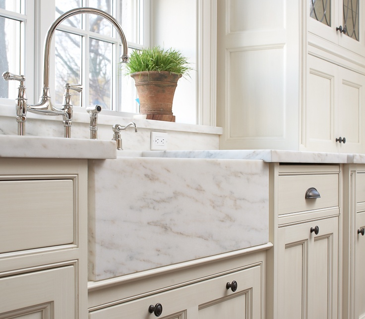 Beautiful White Kitchen With Marble Apron Front Sink And Bridge Faucet