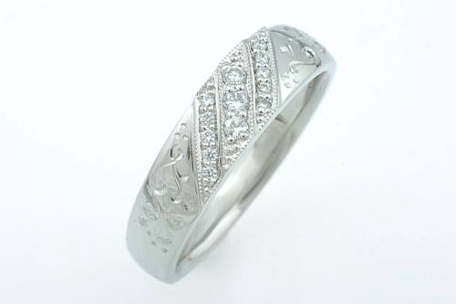 Palladium and diamond ring with hand engraving. CaiSanni